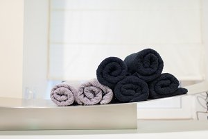Pink and black rolled-up towels in the Spa
