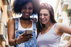 Beautiful women using a mobile.