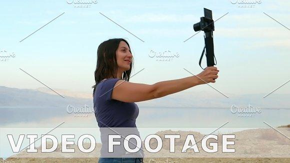 Brunette Longhair Woman Takes Selfie In Mountains