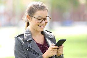 Girl wearing eyeglasses texting