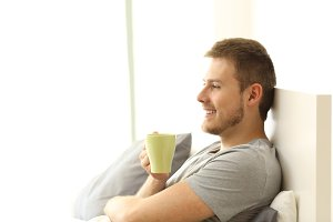 Happy man holding coffee cup