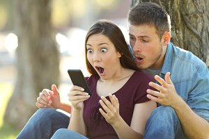 Surprised couple finding content