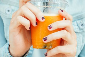Teen girl hands with smoothie.jpg
