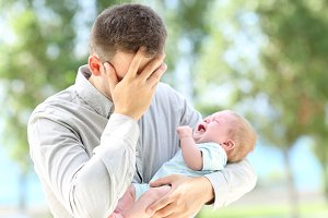 Worried father and baby crying