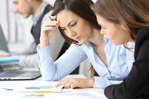 Businesswomen analyzing graphs