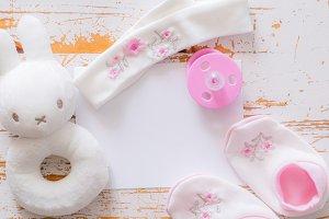 Baby shower concept - child essencials on wood background