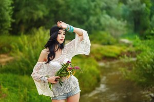 Boho Girl with bouquet wildflowers