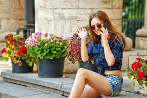 Hipster girl talk to phone