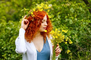 Girl holding bouquet of wildflowers