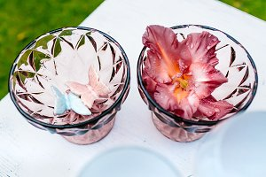 Glass vases with flower and decor, a beautiful decoration in a wedding.