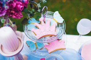 Pink cookies in the shape of a crown on a pink plate. Wedding decoration