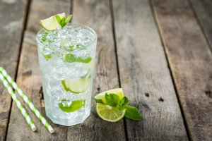 Mojito in glass on rustic wood background
