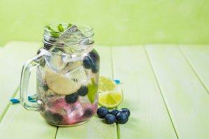 Blueberry mojito in glass jar