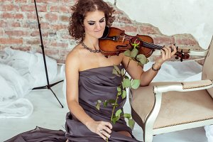 beautiful woman playing the violin bow rose