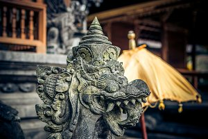 Statue in ancient ruined cave temple Goa Gajah, Ubud, Bali. Elephant temple on Bali island.