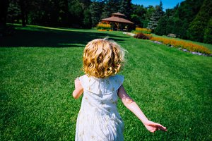 Child Running Through the Grass