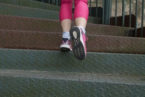 Woman athlete climbing stairs