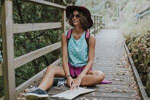 girl sitting with map making hiking and adventure