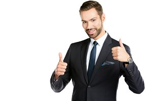 Smiling businessman with thumbs up.