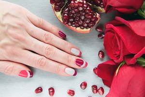 Art manicure with pomegranate