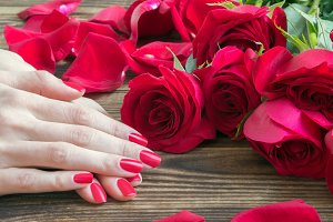 Red manicure and roses