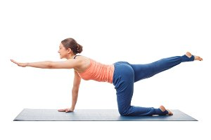 Woman doing Hatha yoga asana isolated