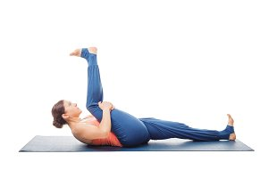 Woman doing Yoga asana Supta padangusthasana isolated
