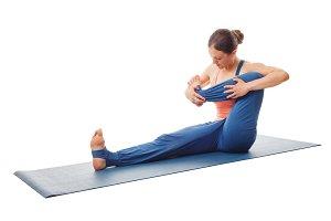 Woman doing yoga - baby rocking exercise