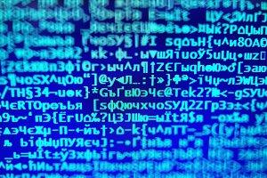 Blue hacker code on display console bokeh backdrop
