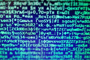 Vintage hacker code on display console bokeh backdrop