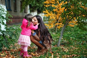 Mom with daughter in autumn park