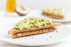 Wholemeal Bread Toast with mashed avocado and chilli flakes