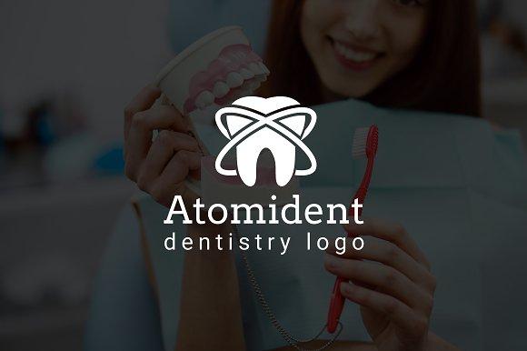 Atomident Dental Dentist Logo