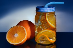 Beverage with oranges and ice