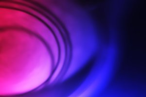 Spherical pink and purple motion blur background