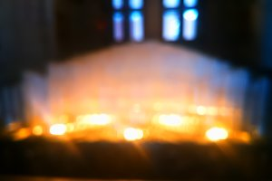 Indoor interior candles in front of the window bokeh background