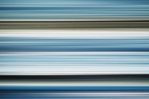 Horizontal wide blue grey blurred bokeh abstraction background b
