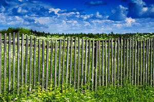 Square vivid summer village fence horizon cloudscape background