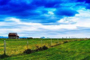 Horizontal classic Norway landscape house cloudscape background