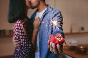 Romantic young couple celebrating