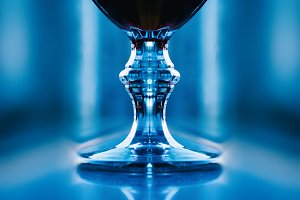 Vertical symmetric glass of wine abstraction backdrop