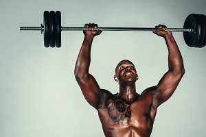 Muscular african man exercising
