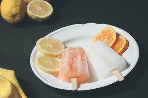 Citrus popsicles on Dark Background