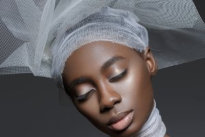african girl with veil hat