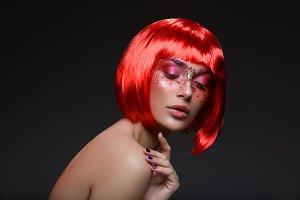 Beautiful girl in red wig
