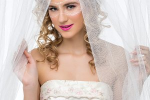 Bride with mask drawn on face