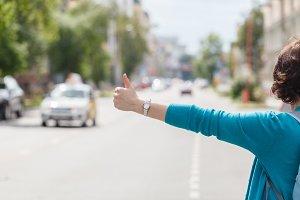 Raising hand standing on road