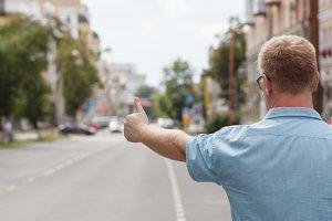 man standing on the city street