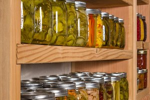 Pickles on wooden shelves