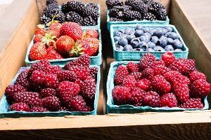 Fresh picked berries in wooden box